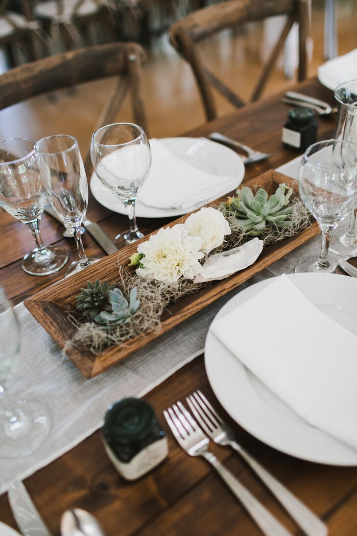 """The wedding's decor was centered on Maine's fusion of natural, rustic vibes and coastal elegance. They discussed pulling their palette from Eventide Oyster (their favorite restaurant in Portland, Maine) with their planner, Sarah Goodwin of Daisies and Pearls. She suggested they incorporate oyster shells into all the centerpieces and decor. """"We loved how it helped bring in that coastal element,"""" Emily says."""