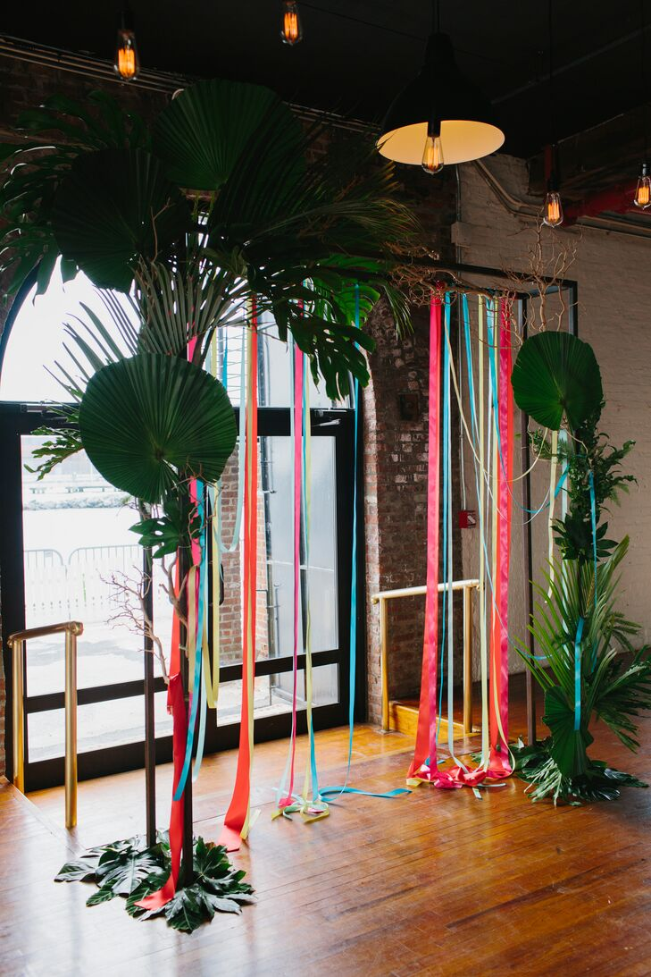 Colorful Palm-Trimmed Ribbon Ceremony Backdrop