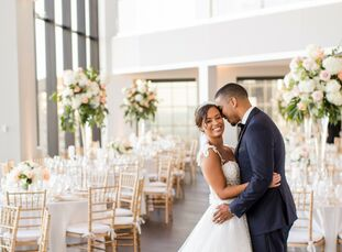 "For their wedding in Boston, Alex and Steven chose The State Room because of, ""its beautiful views of the city, the fact that it had two floors which"