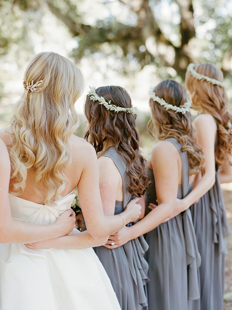 Boho bridesmaid style with loose curls and flower crowns