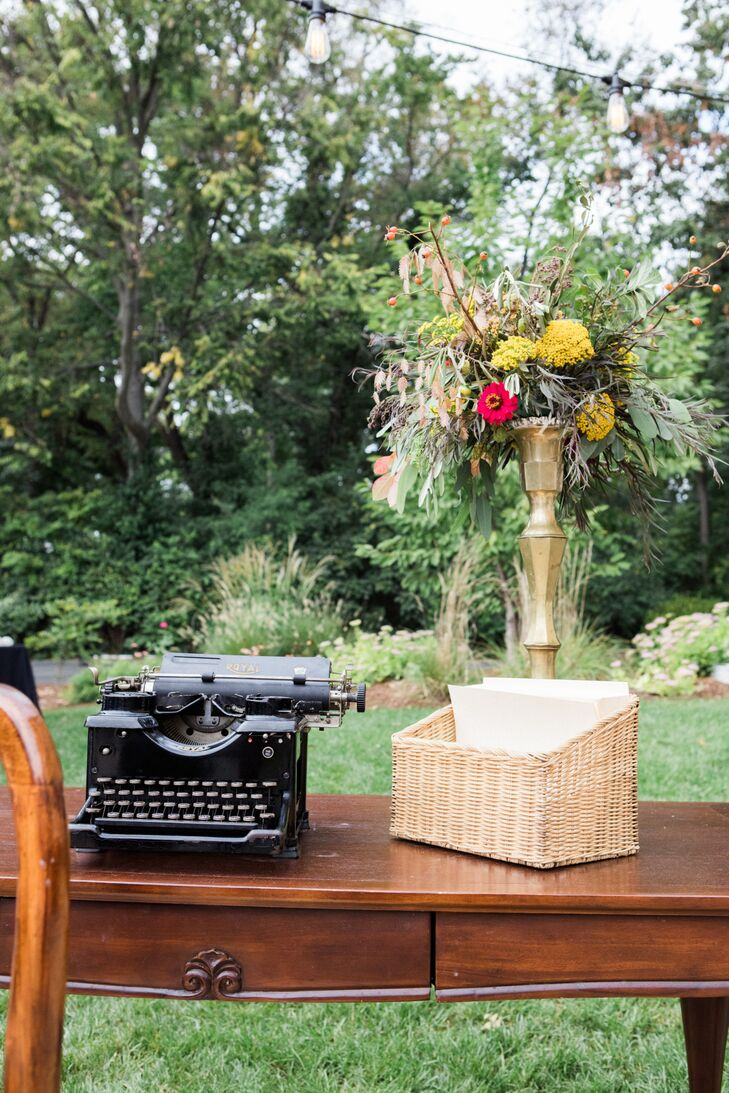 "Kassie and her sisters grew up typing on a vintage typewriter, repaired and resurrected for this special occasion. Kassie borrowed the idea from a friend to have guests type well wishes, funny stories or sentimental notes on the typing paper, in lieu of a guest book. ""We ended up framing a few of our favorites,"" she says. ""It was a great way to capture the spirit of the night."""