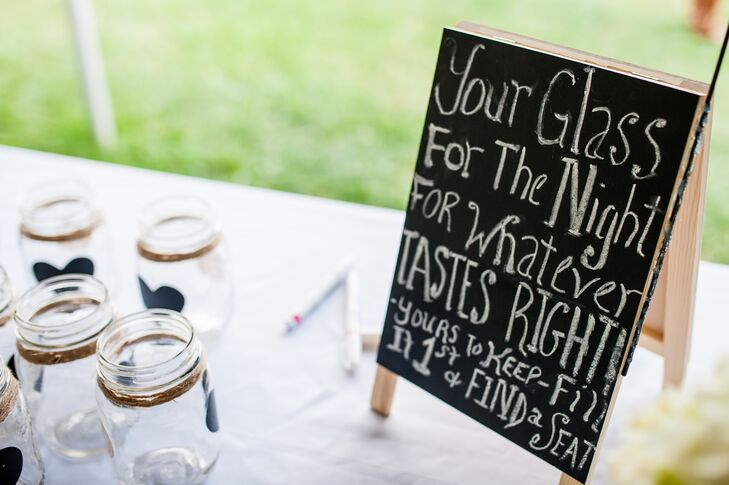 As wedding favors, Megan and John gave their guests mason jars with chalkboard labels so that they could use them during cocktail hour.