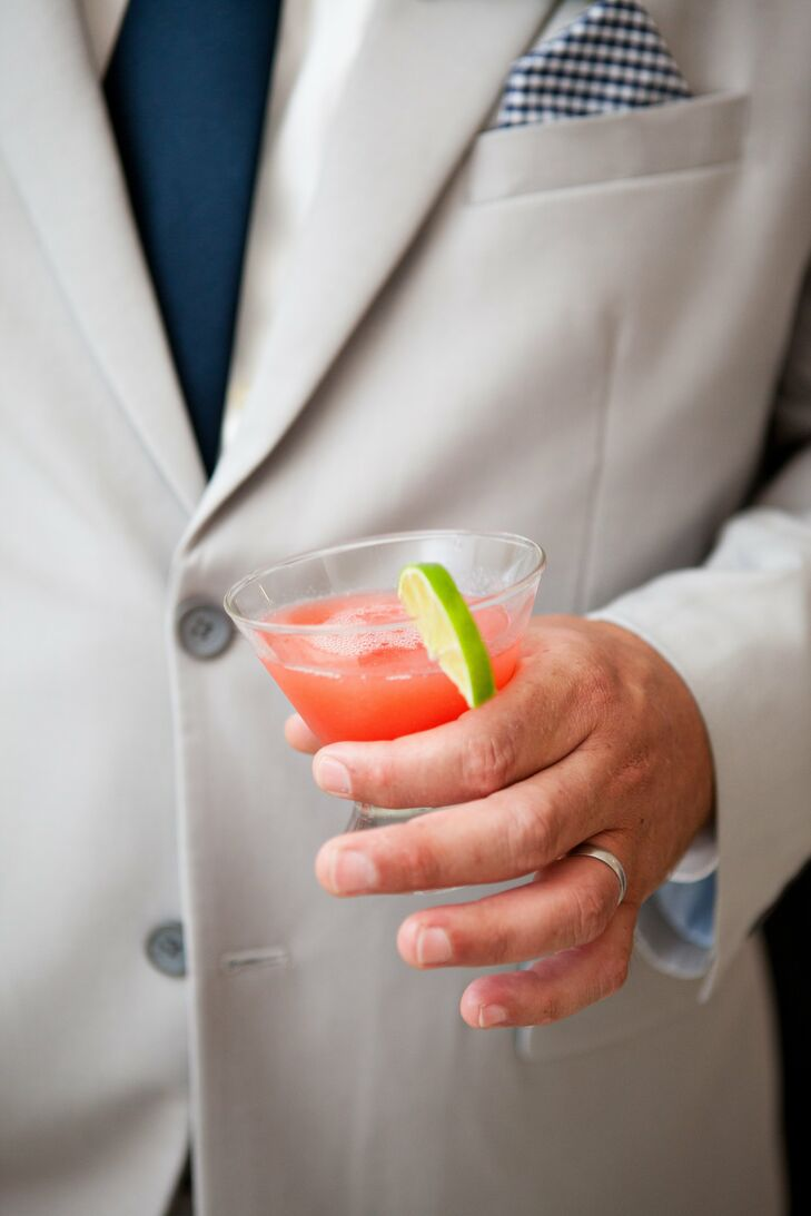 Guests sipped on refreshing cosmopolitans during cocktail hour. The bright cocktails complemented the affair's vibrant color palette.