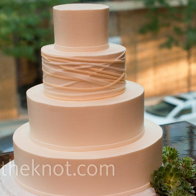 Eric was in charge of the cake, and he came up with a modern design with simple fondant bands on one tier.