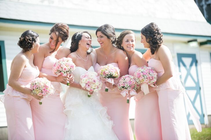 The bridesmaids wore light pink floor length gowns with a sweetheart neckline.