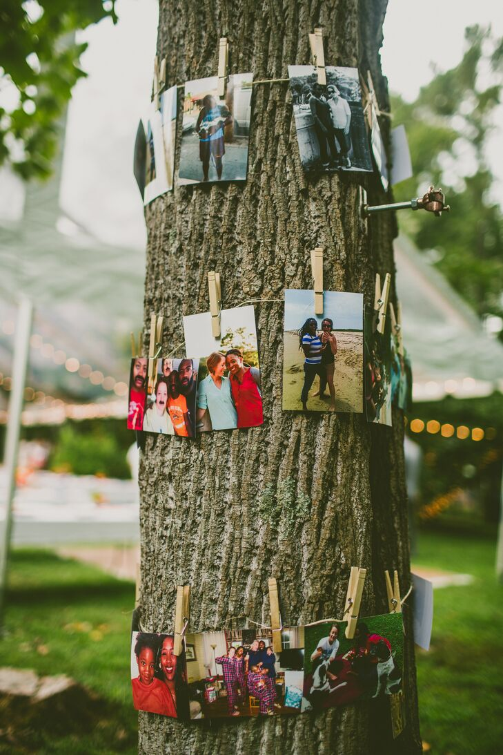 Keeping the decor simple to focus on the homegrown flowers, Erin and Jessica strung pictures of close family and friends and wrapped them around the trunks of trees at the reception in Pittsboro, North Carolina.