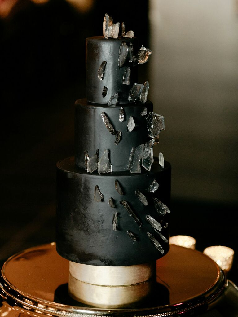 Three-tier black wedding cake with geode decorations