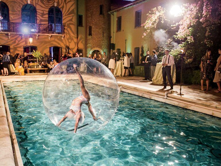 Acrobatic poolside performer wedding reception idea