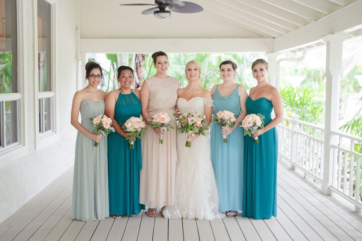 The bridesmaids wore floor-length dresses in different styles from AfterSix.com. Erica's Maid of Honor stood out among the green hues with a champagne colored dress.  All paired their outfit with an updo hairstyle, wedge shoes and simple jewelry.