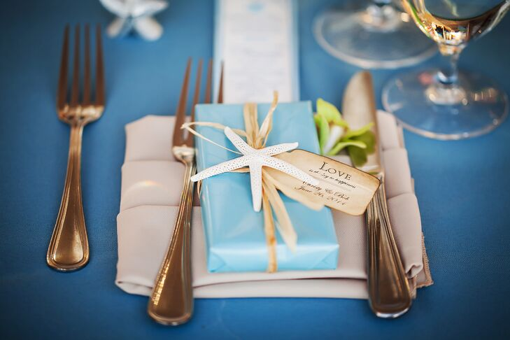 Blue wrapped gift boxes with a starfish tied on top were given to guests as favors.