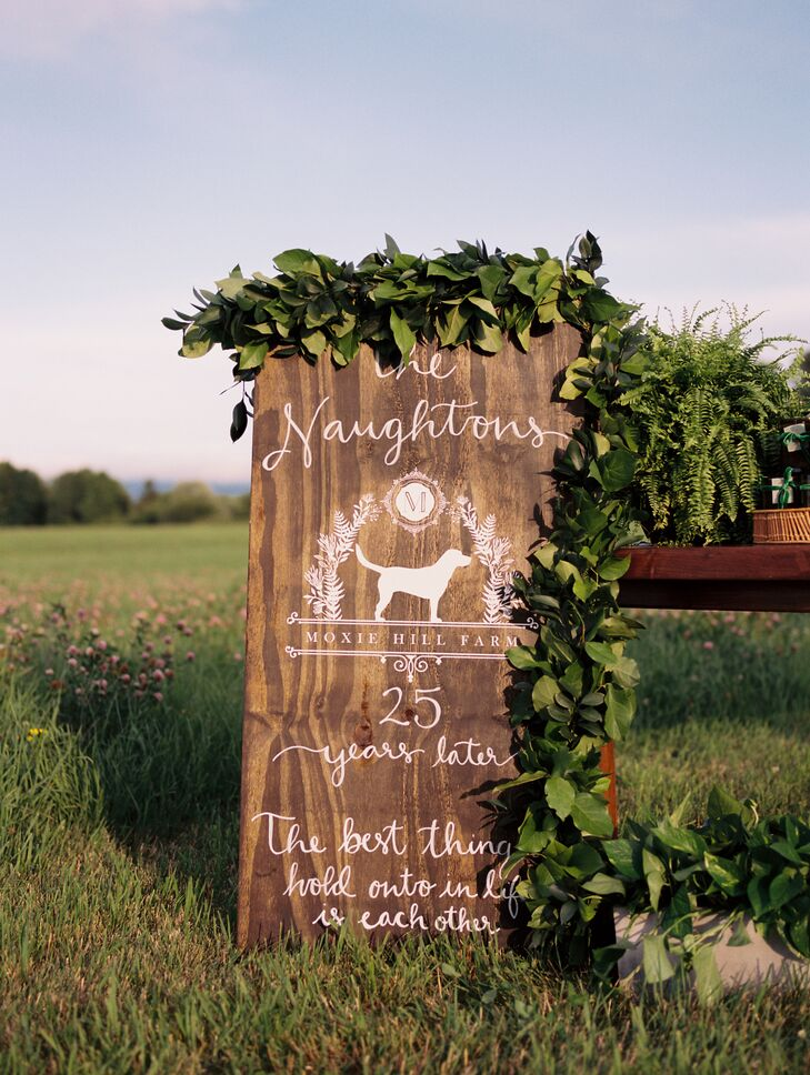 Rustic Wood Sign with White Calligraphy and Garland