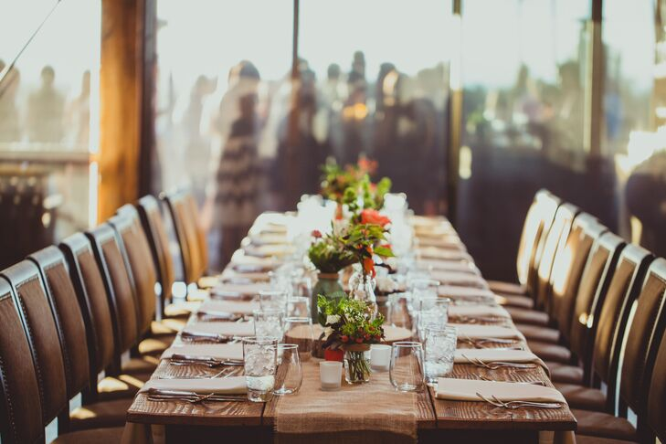Wood dining tables were decorated with small plant and flower centerpieces down the middle.