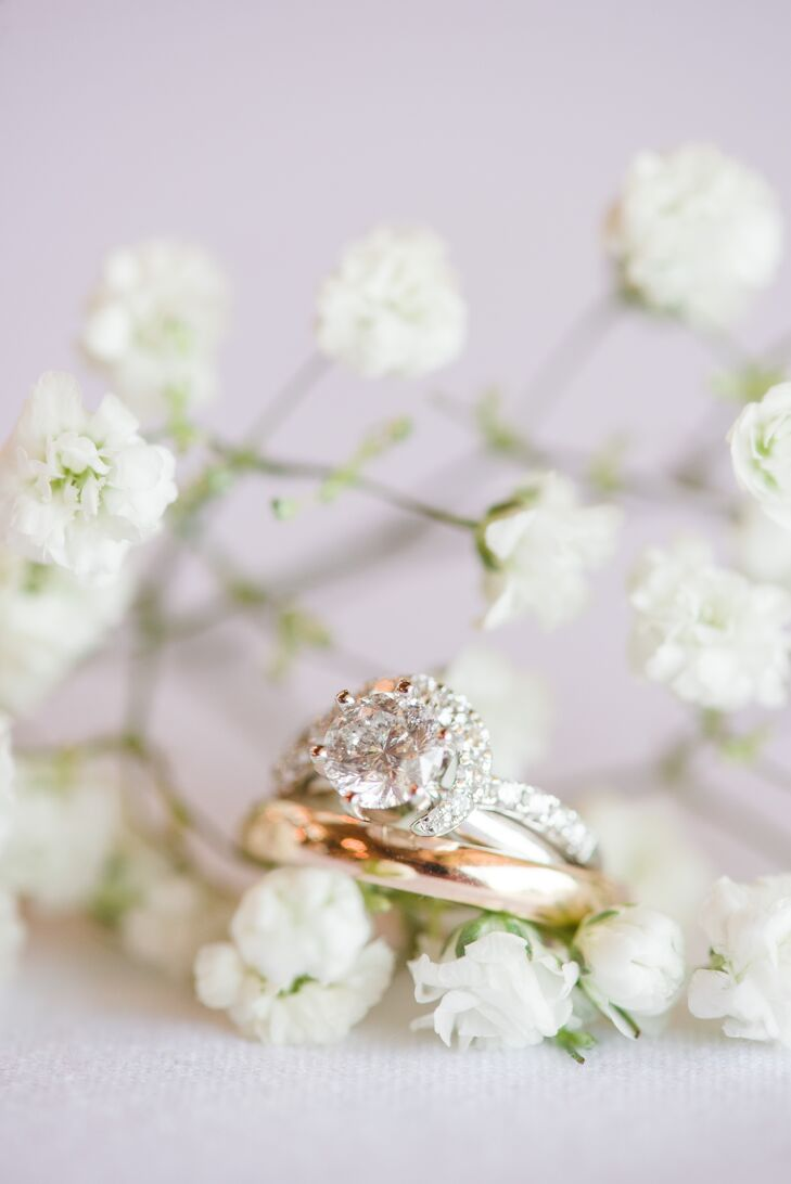 Instead of a traditional wedding band, Brianna had a white gold diamond wrap added to her 1 carat diamond engagement ring. Barrett opted for a classic yellow gold band that had belonged to his great-grandfather, making the ring that much more sentimental.