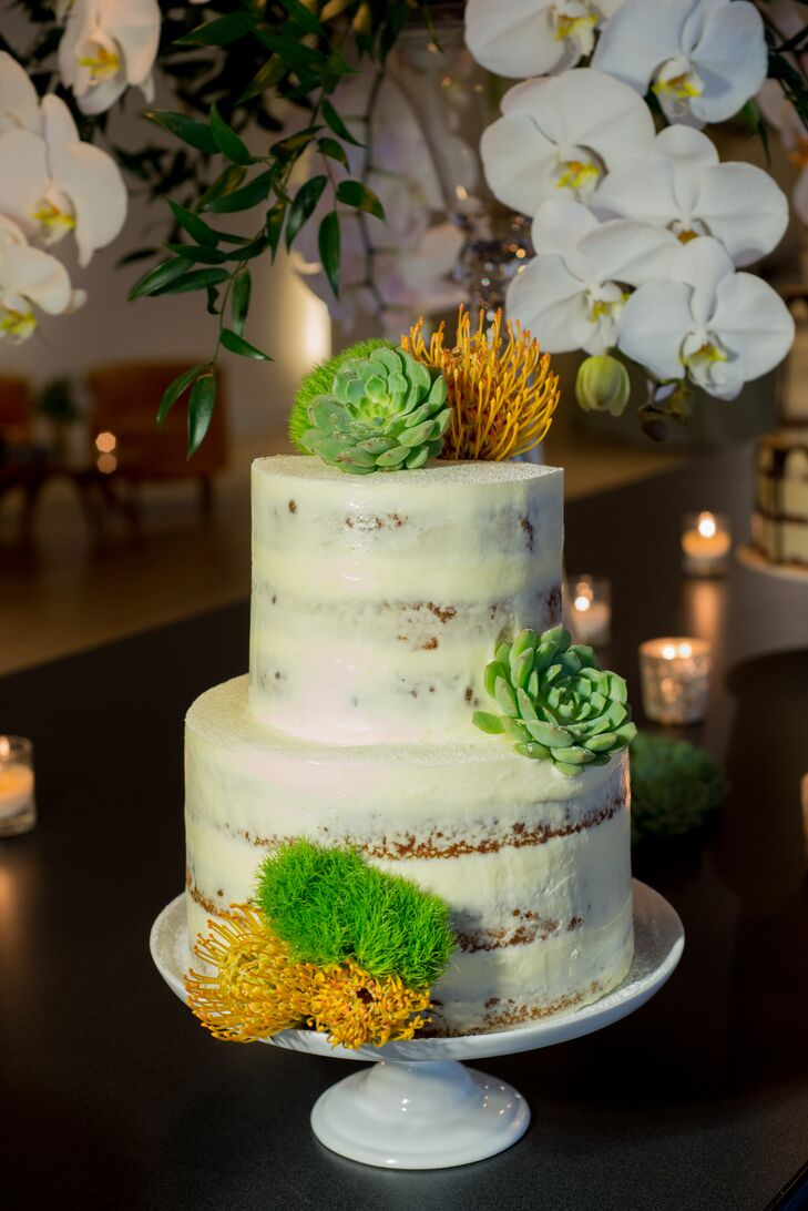 For dessert, Kelly and Brett served three separate wedding cakes baked by Broken Tart bakery, including this olive oil confection topped with a citrus glaze and fresh succulents.
