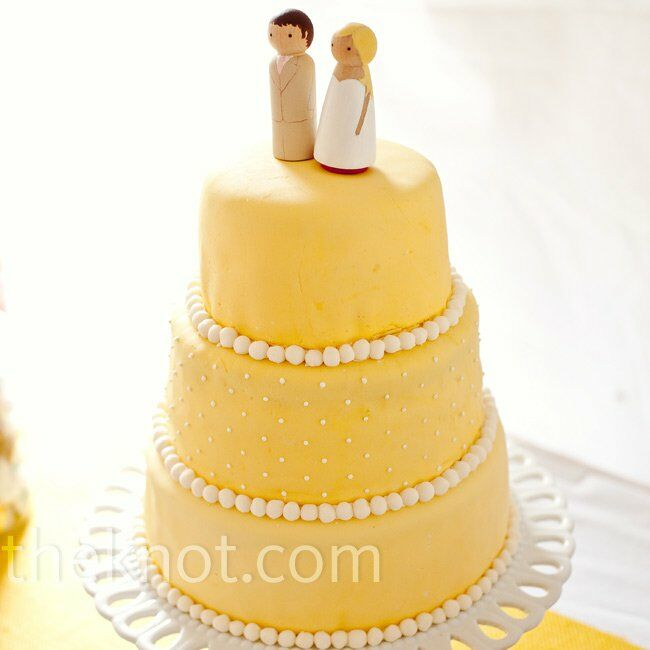 Sarah's sister made the couple's cake. Bride and groom wooden toppers (made by Sarah) completed the simple look.