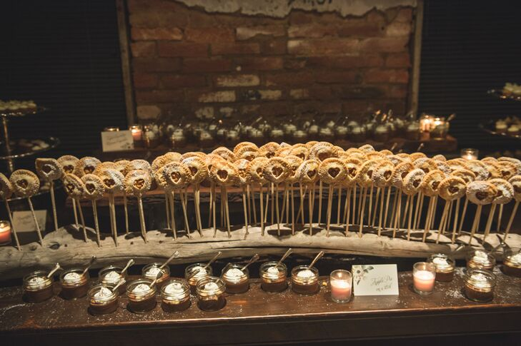 """A dessert bar was set up during inside the space, where cocktail hour had taken place,"" Corinne says. ""Desserts included apple pies on a stick, reinvented s'mores, passion fruit cupcakes and triple chocolate mousse trifles."""