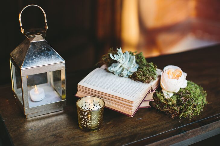 Instead of traditional floral centerpieces, votive candles were set beside glass-encased book-and-floral centerpieces—a touch that appealed to Jordan, who is an avid reader and an archivist.