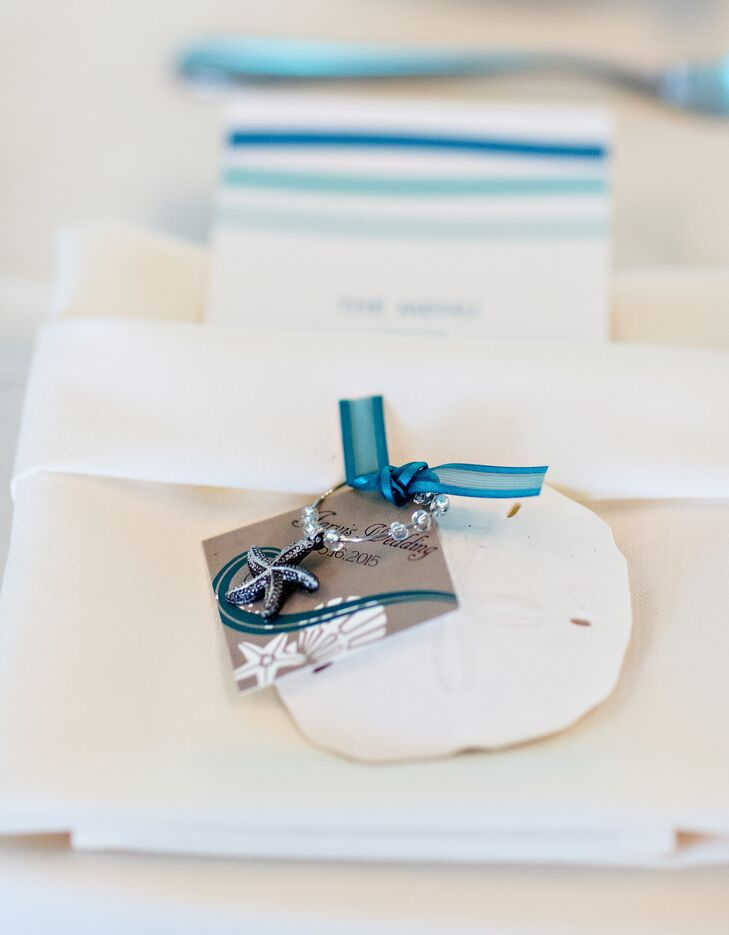 The striking setting of Cape Cod, Massachusetts, served as the inspiration for the entire affair. Lindsey and Keith looked to a bright color palette of teal, blue and sea green to infuse the Ocean Edge Resort with life, adding beach-inspired elements like seashells and sea glass into the design of each tablescape to play up the locale's seaside location. As a token of their appreciation for their guests' love and support, the couple sent their friends and family members home with sand dollars and starfish wine charms.