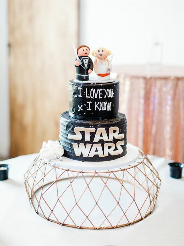Custom black Star Wars-themed wedding cake with custom toppers