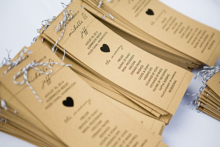 When guests entered the ceremony space, they each grabbed a thin kraft-paper program with heart-shaped designs decorating the front. Baker's twine tied in bows topped each wedding program.
