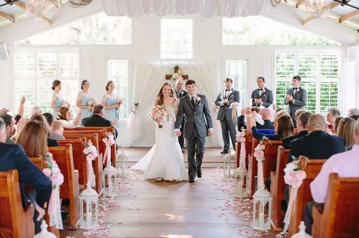 The chapel was decorated with draped sheer chiffon along the ceiling and altar cross.