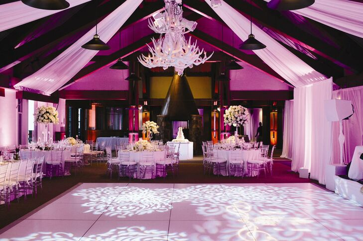 The custom white antler chandelier was the focal point of the reception decor.