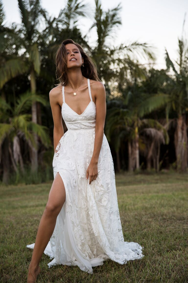 Grace Loves Lace Elixir Collection wedding gown with a leg slit and V-neckline