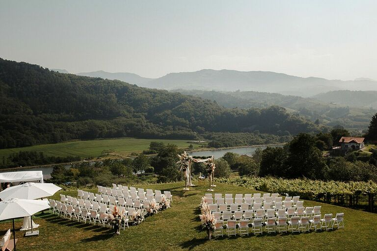 Outdoor wedding ceremony overlooking hillside