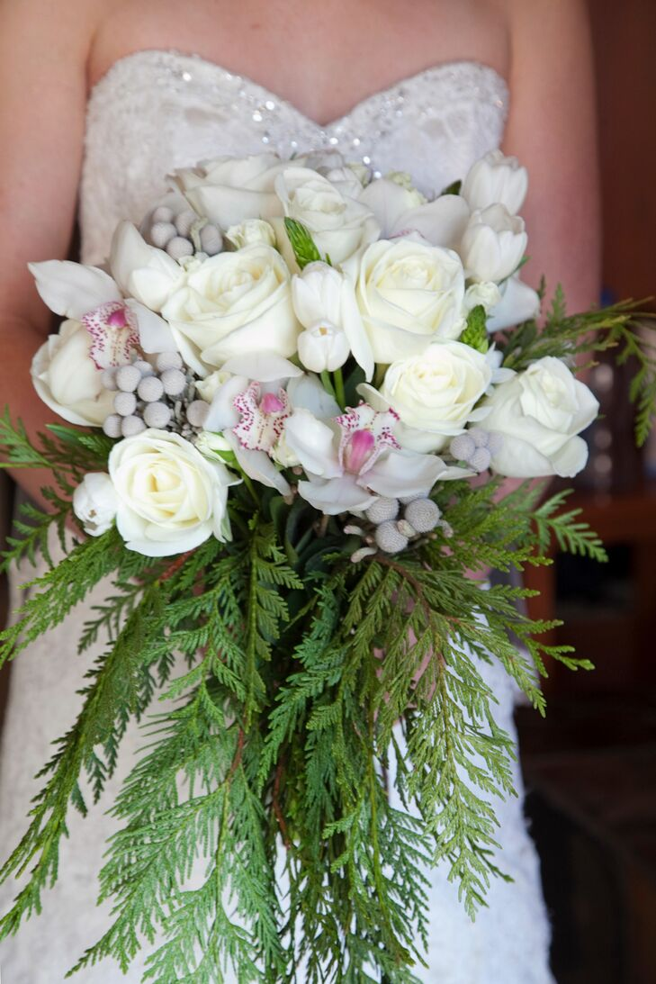 Bryanna carried white roses, tulips, orchids, silver brunia balls and pine in her winter-inspired bouquet.