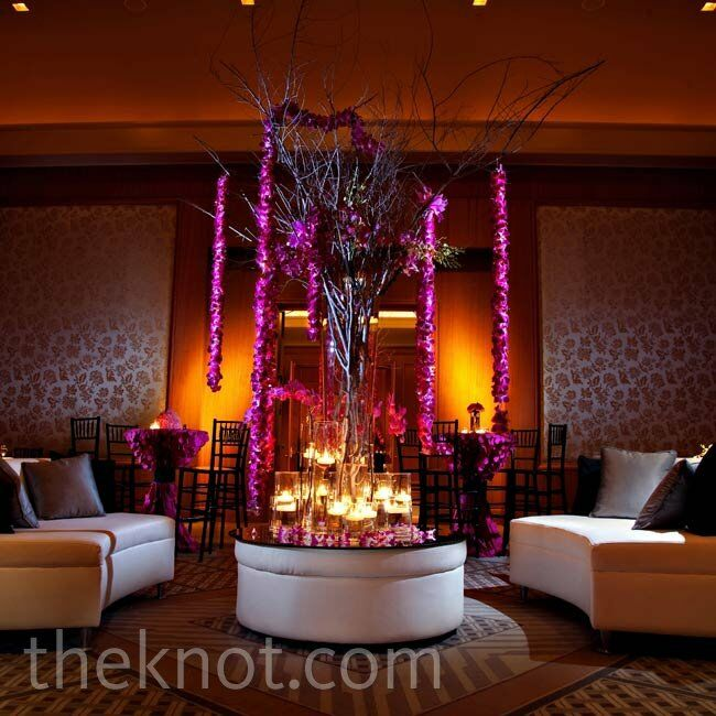 A lounge area, complete with sleek white couches and tall cocktail tables, set a swanky scene.