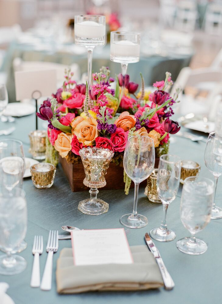 Small round bursts of colorful flowers were bundled as the table's centerpieces.