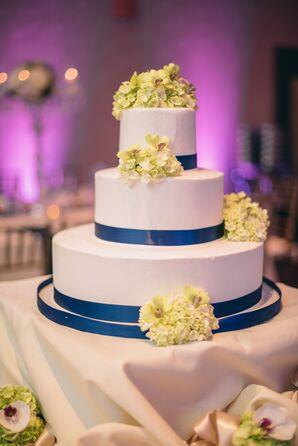 Three-Tiered White and Blue Wedding Cake
