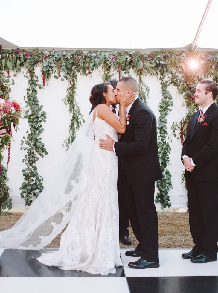 Danika and Frankie exchanged vows outside before a backdrop artfully draped with a dozen green garlands. They then led their 250 guests into the tented reception at Frankie's parents' home in Bakersfield, California.