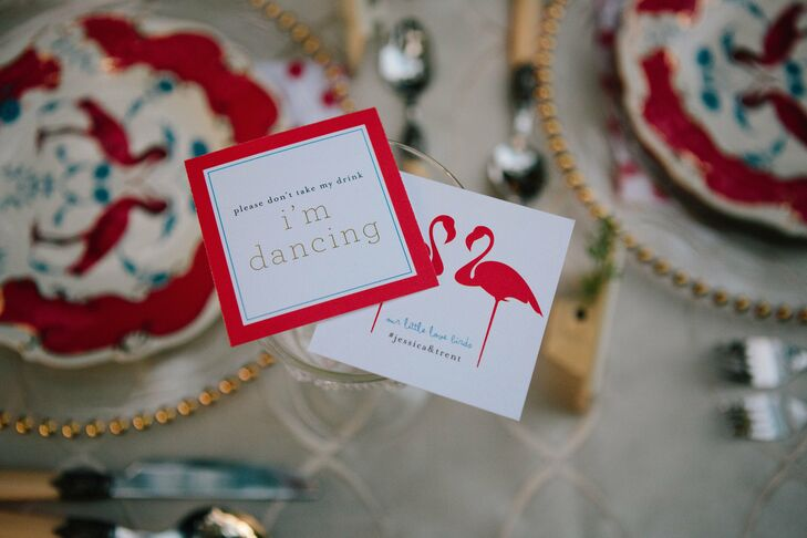 Colorful cards held guests' drinks as well as listing the official hashtag for social media photos of the wedding.