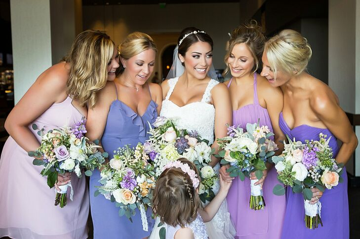 Dana's bridesmaids wore various Alfred Angelo dresses, each in a different shade of purple.