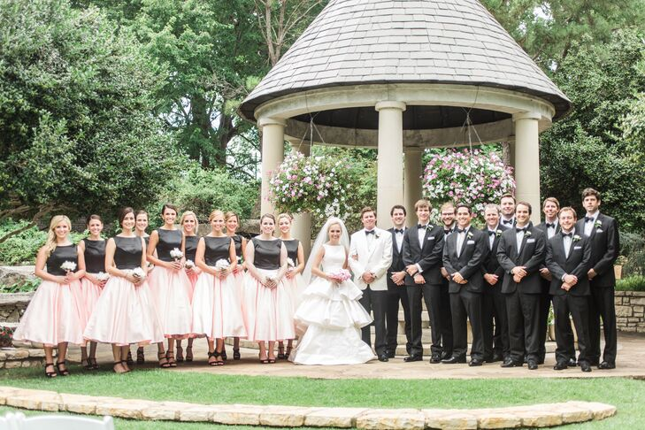 """We had 10 groomsmen and three ushers. They all wore classic black tuxedos,"" Ivy says. ""We selected rental tuxedos for the guys, but some opted to wear their own. You can't tell the difference! Their bow ties were a gift from Mark and had their monogram embroidered on the inside."""
