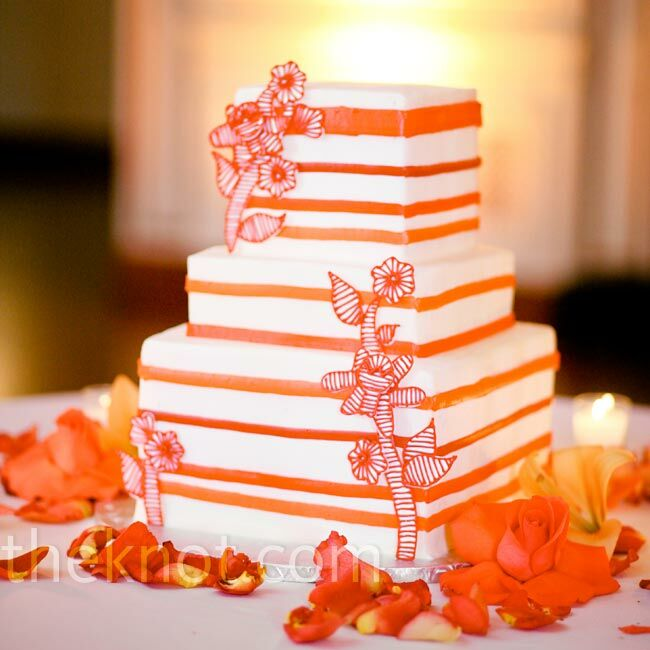 Art Deco–style sugar flowers decorated the white-and-orange buttercream cake.