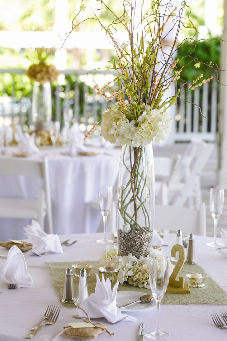 The centerpieces were all different; we had some tall ones with large glass vases and lower spouting out of the top, says Holly.
