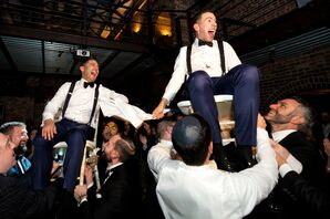Grooms Lifted on Chairs at Wedding in New York