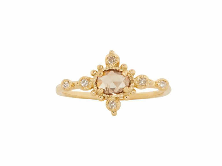 brown rose cut diamond in intricate yellow gold setting