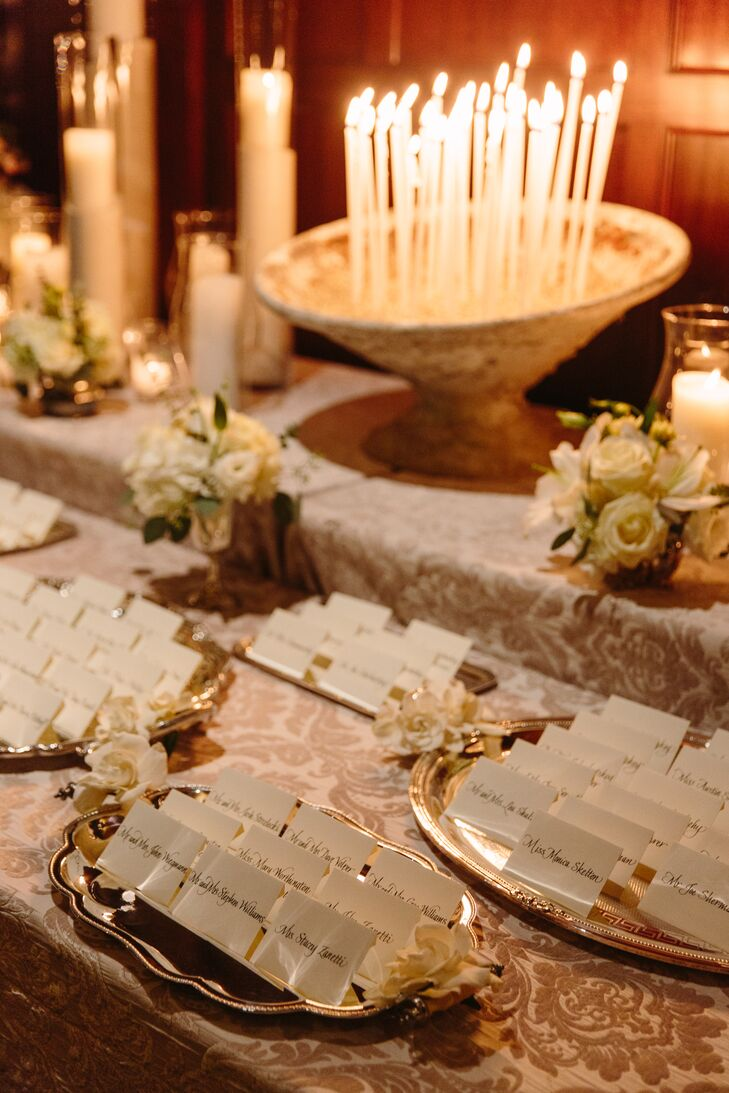 At the reception at Julia Morgan Ballroom, guests found their names—written out by Michele Papineau Calligraphy—under warm candlelight on silver trays.