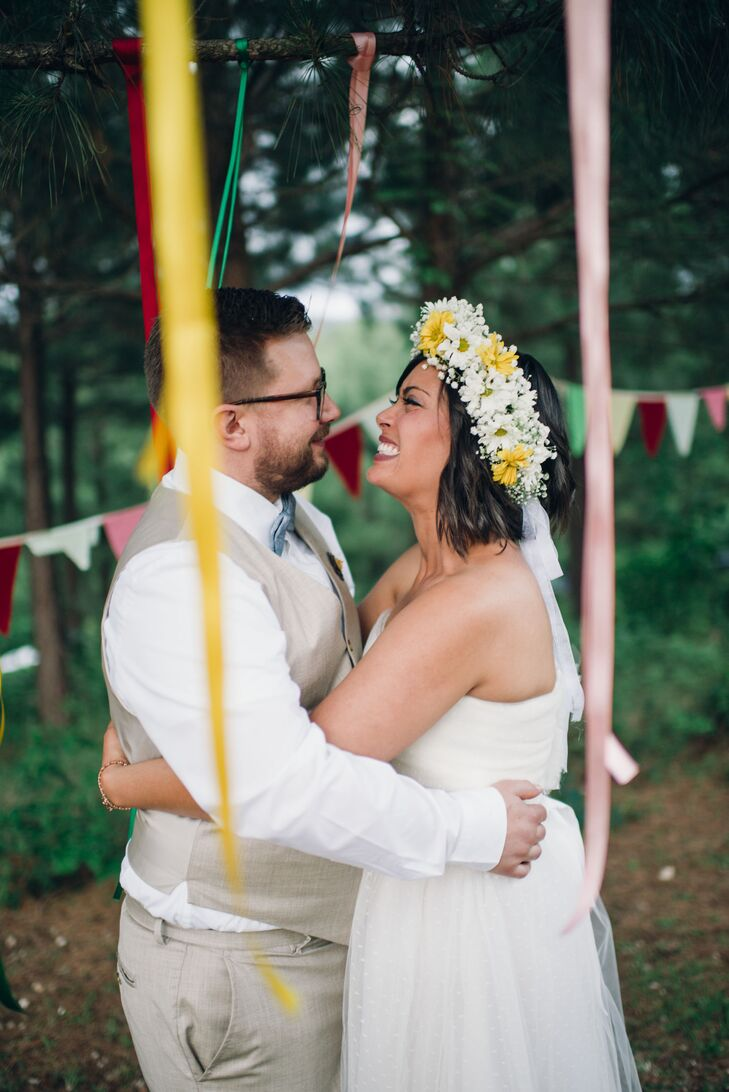 Namia wore a yellow and white daisy and baby's breath flower crown to tie in the boho, woodland wedding theme.