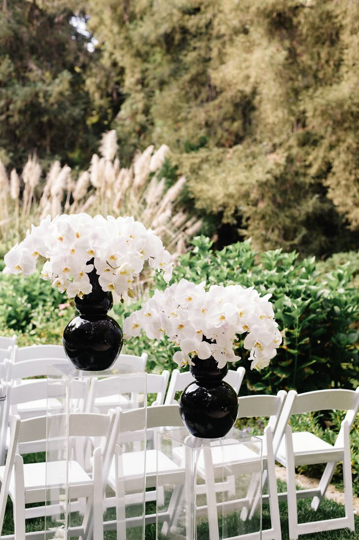 Gorgeous white orchids were displayed in large black vases at the ceremony.