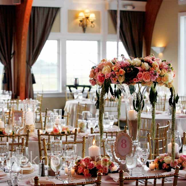 The tables were decorated with high and low arrangements with candles and roses. Sand in the vases nodded to the beachside setting in a subtle way.