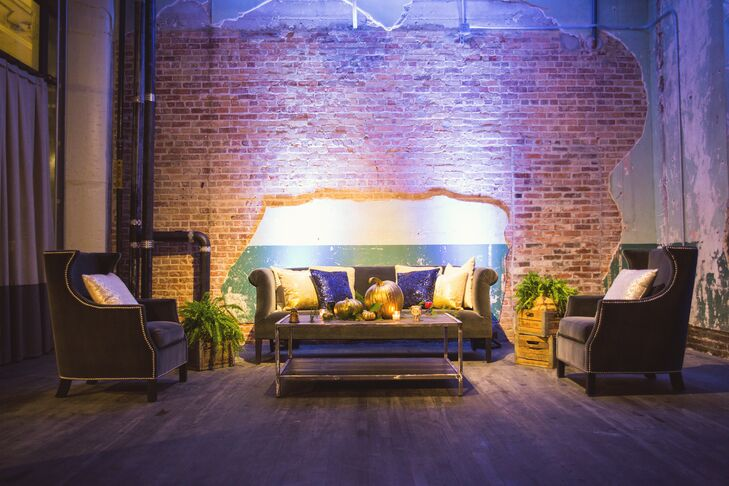 Glam Navy Sofas Against Exposed Brick Wall