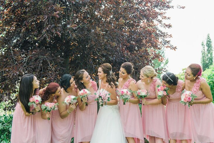 The bridesmaids wore one shoulder pink dresses with gold shoes.