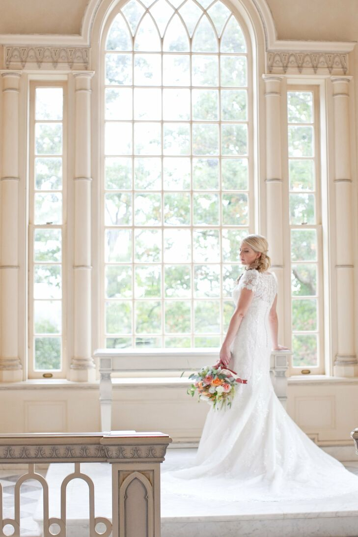 Andrea wore a lace fit-and-flare wedding dress by La Sposa. She paired it with a lace bolero.