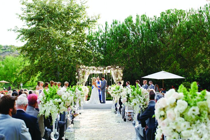 "The late-afternoon ceremony was held on the country club's lush terrace against a backdrop of wildflowers. ""The effect was definitely A Midsummer Night's Dream,"" says Jessica."