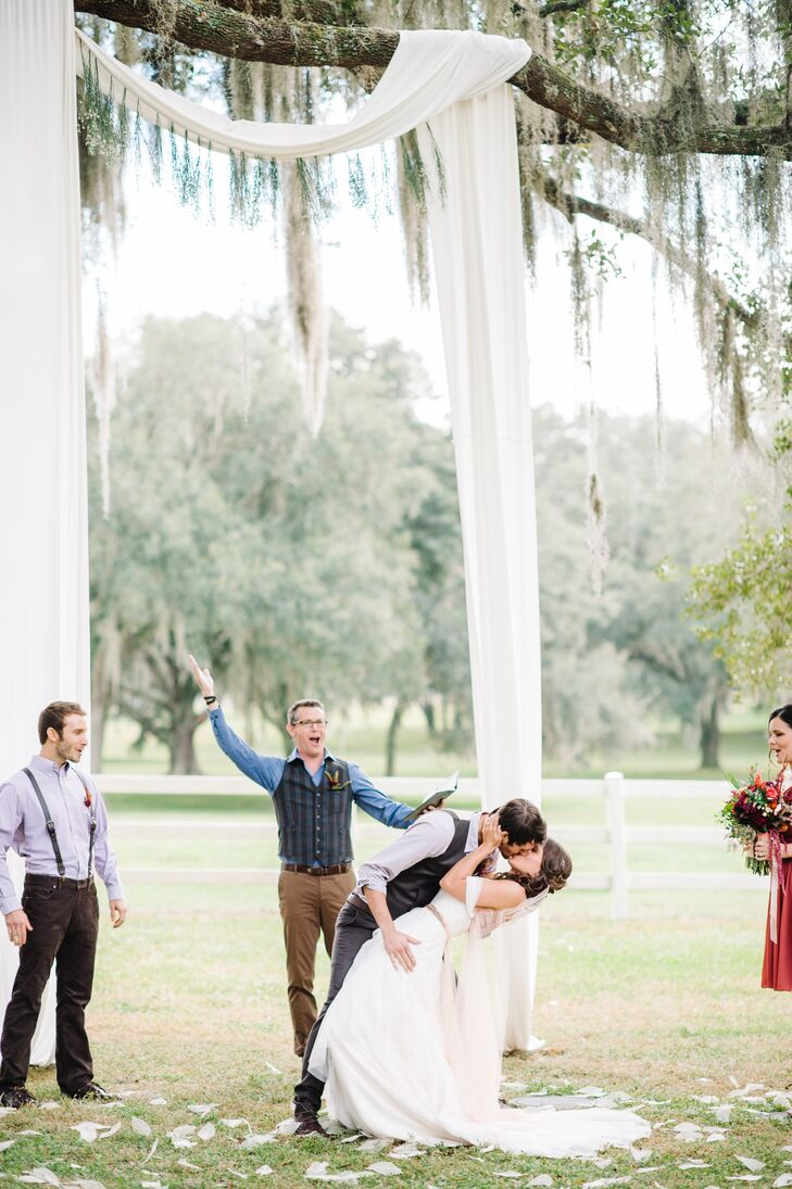Even their ceremony decor had a sweet, natural flair to it. Shelby and Zack shared their first kiss in front of a chic wedding arch that included yards of ivory fabric draped over the limb of a grand oak tree. Ivory skeleton magnolia leaves were also scattered throughout the ceremony space.