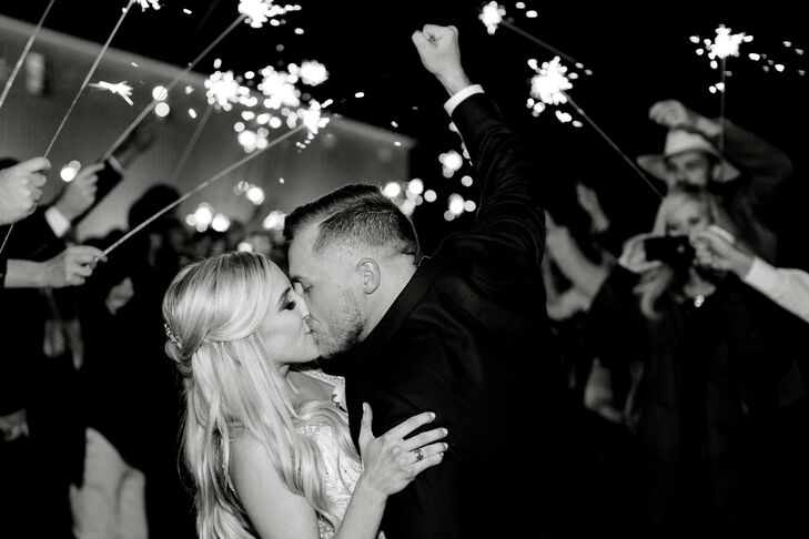 Bride and Groom Kissing During Classic Sparkler Exit